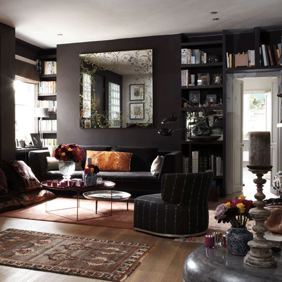 22-dark-living-room-with-black-walls-colorful-accessories-and-various-textiles